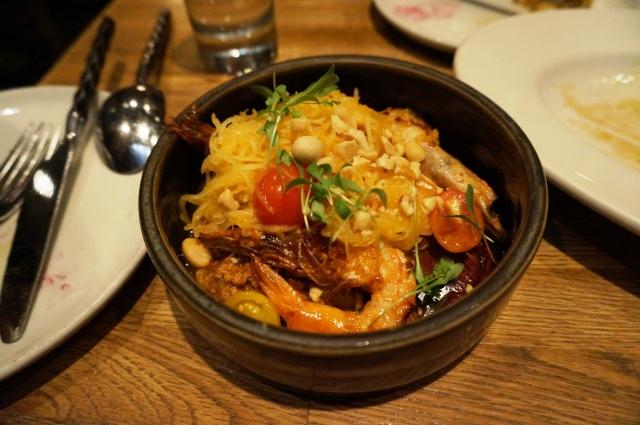 Sauteed shrimp with peanut-pork ragout, spaghetti squash, grape tomatoes